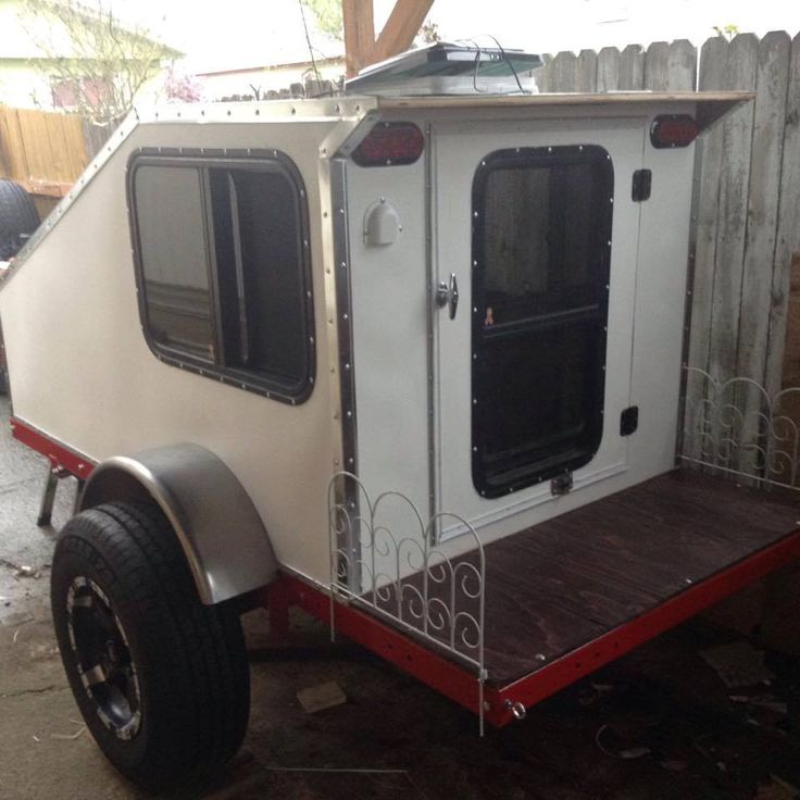 Camper With Outdoor Kitchen: Here Is An Example Of A Compact Rear Entry Style Camper