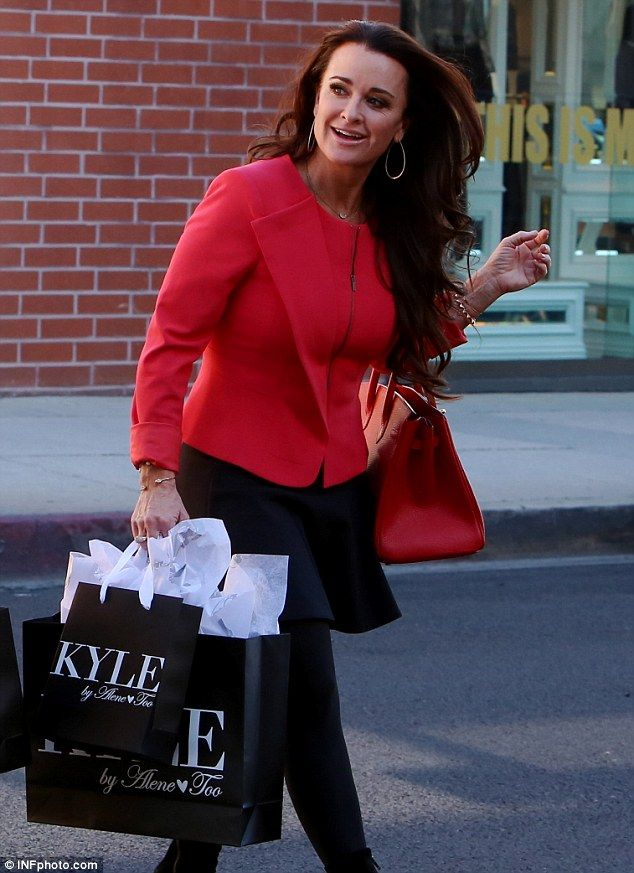 No falter in her step: Kyle Richards looked to be in high spirits as she enjoyed a bit of retail therapy in Beverly Hills, on Monday