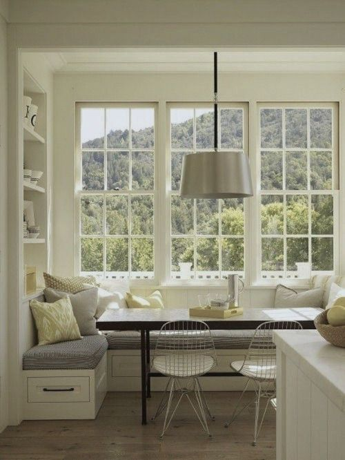 Gorgeous banquette, industrial light, large windows, creamy palette - this is a beautiful kitchen. Seda y Nacar