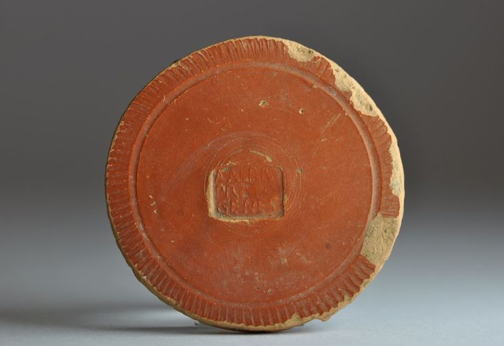 Roman potter stamp, roman potter name, roman inscription on terra sigillata aretina, 20-1 B.C. Roman potter stamp, roman potter name on arretine ware, central Italy, bottom of a cup with makers name A·ALBIV / PROTO / GENES, A. Albius Protogenes, 5.3 cm diamater. Private collection