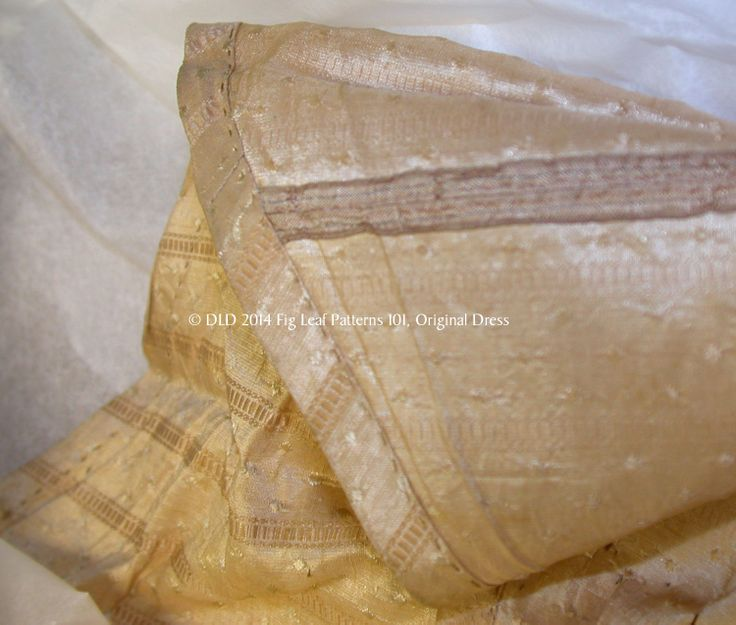 Showing selvedge of the silk with a faint blue line, as well as hem of skirt of gown c. 1770s.  Sumter County Museum, SC.