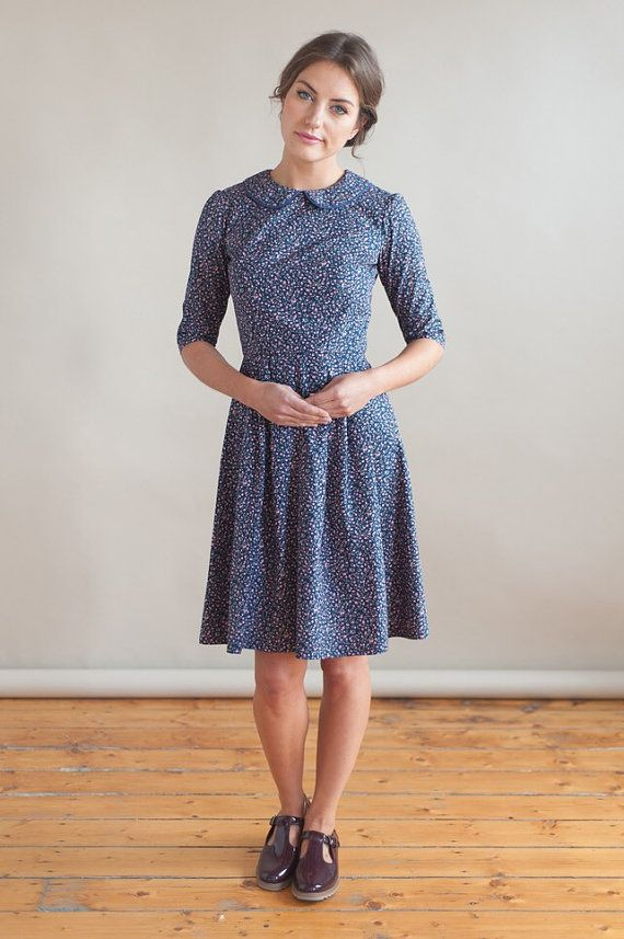 This pretty dress is made from a navy cotton fabric with lovely floral print. The fitted bodice has a round neck and peter pan style collar with blue piped edging. The skirt has several pleats at the front and back with concealed zip fastening down the back.  All garments are handmade in Manchester and take around 4-5 working days to make.  Available in sizes:  UK 8 - 26 Waist 34 Chest UK 10 - 27.5 Waist 35 Chest UK 12 - 29 Waist 37 Chest UK 14 - 31 Waist 39 Chest UK 16 - 33 Waist 41 Chest…