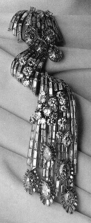 Mauboussin - An Art Deco platinum and diamond double clip, circa 1939. Created for the International Exhibition in New York, 1939. Source: Mauboussin - Marguerite de Cerval, 1992.