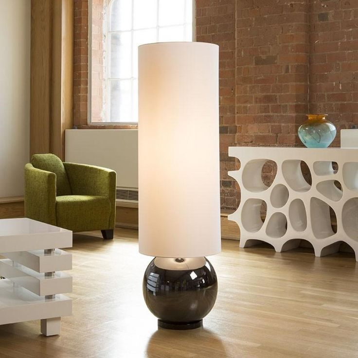 Envy Lighting designer standard floor lamp large silver/white Neve.  Stunning chrome coloured ceramic orb base combined with an oversize delightful cotton shade.  Simplicity is the key for its beauty and elegance.  Exquisite delicate off-white fabric shade looks like a million dollars.