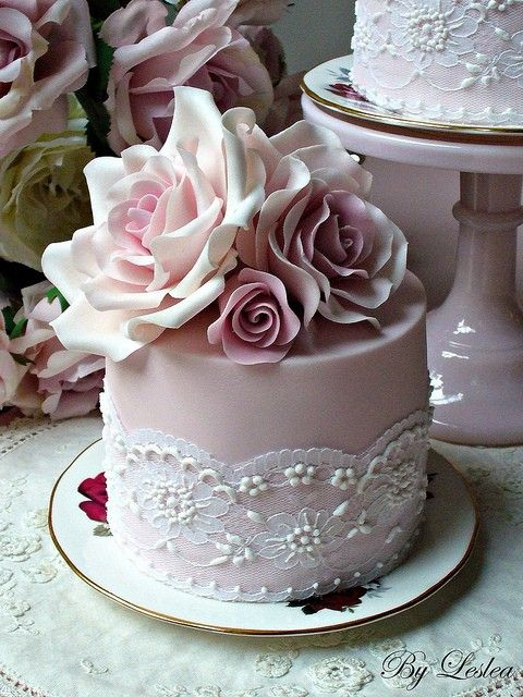beautiful cake with real lace around and edible flowers! The antique rose color just really makes it stand out.