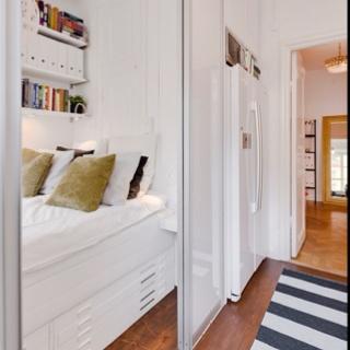 Door Solutions For Small Spaces bråvallagatankitchen/bedroom! bed is behind sliding doors from