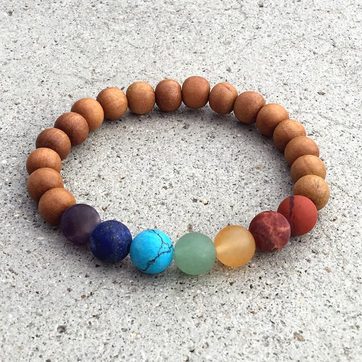 Simple chakra bracelet, made with matte chakra gemstones, for balancing your chakra energies, made with high quality sandalwood mala beads. Each of them represents a different chakra, red jasper, pica