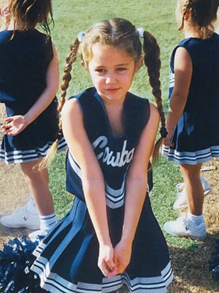Little Miley Cyrus as a Cheerleader  ( and well before twerking -- gosh yeah -- miss this miley :[ )