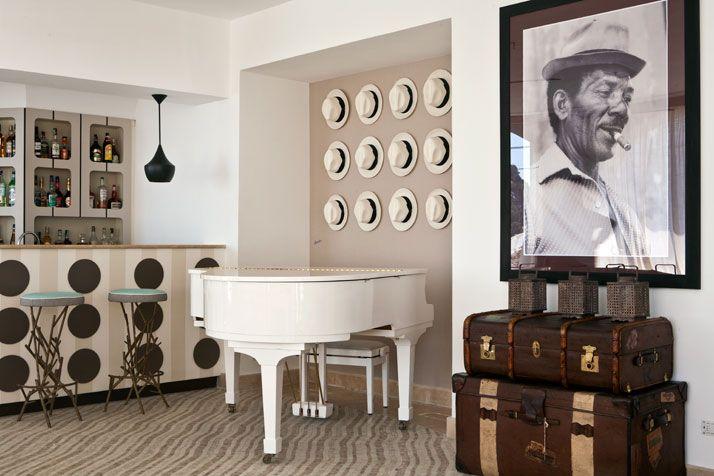 Capri tiberio Palace, Dixon lamps, hats as art, branch stools, hospitality, mosaic floors, luggage, black and white photography