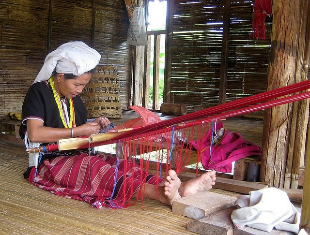 """""""Karen hill tribe lady with loom"""" by Carpe Feline on Flickr  the ladies sit on the floor of their huts and weave with this kind of loom and sell the woven goods, scarves, and jackets to the tourists. Chiang Mai, China"""