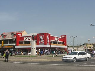This branch of KFC in Independence Square was awarded for selling the most chicken in the world, it also made the most money worldwide. (Mainly due to the carnival season)