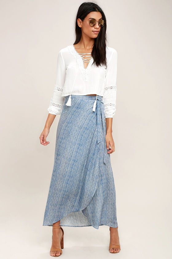 The Anniversary White and Blue Striped High-Low Wrap Skirt turns every day into a special one! Light and breezy woven rayon is bedecked in a blue and white striped print from the high, wrapping waist (with tying sash belt), to the high-low midi hem.