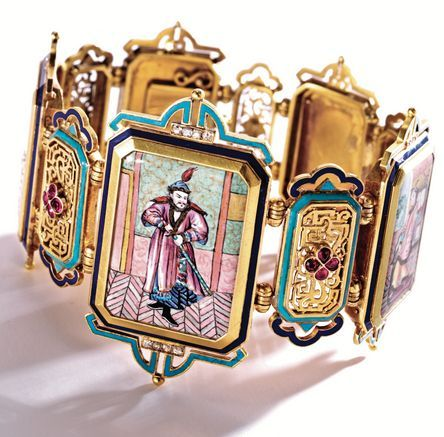 18 KARAT GOLD, ENAMEL AND RUBY 'CHINOISERIE' BRACELET, FRANCE, CIRCA 1865 Composed of five polychrome enamel plaques depicting Chinese theatrical characters, spaced by five pierced plaques applied with quatrefoils of pear-shaped rubies, the borders accented with turquoise and royal blue champlevé enamel and old mine diamonds, French maker's mark and assay marks.