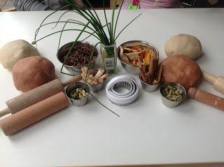 Cinnamon and lemon playdough with cinnamon sticks, cardomom seeds, lemon grass, chives, aniseed stars and lemon peel. {from Preschool Play}
