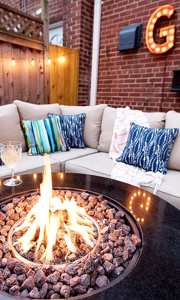 20 Epic Backyard Lighting Ideas to Inspire your Patio Makeover | DIY Outdoor Design Inspiration | Marquee letter light fixture + bistro lights