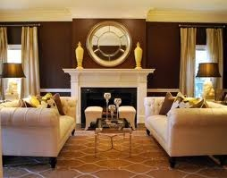a pair of chesterfield sofas flanking a fireplace. I like the ...