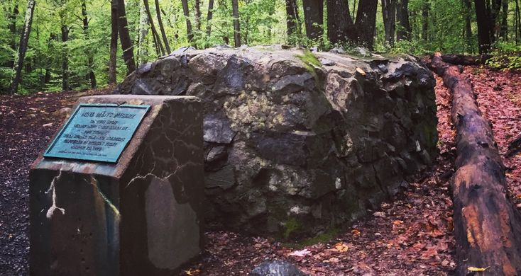 In the woods of Cumberland, RI, Nine Men's Misery marks the spot where nine colonists were captured and killed by the Wampanoag during King Philip's War.