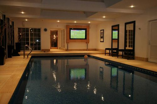 Indoor swimming pool steven gerrard mansion house plans for Mansion house plans with indoor pool