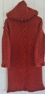 . Duffelcoat. Pattern in Norwegian. Hand knitted jacket with hood, cable knit. Design Annelise Bjerkely