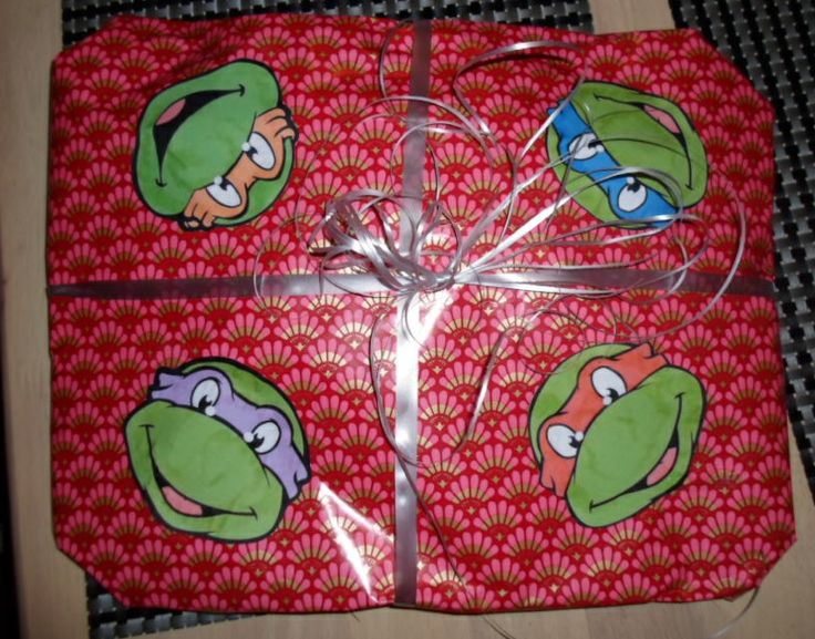 The faces of the four Teenage Mutant Ninja Turtles to decorate a present for my nephew.