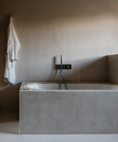 "House tour: a fashion photographer's Tuscan farmhouse : The flow between rooms gives Sposito and the many family and friends who visit regularly space to be all together or alone. ""Every room has its own via di fuga — a private escape for people to come and go from the house, whether it's to the pool, terrace or garden, without having to pass anyone else,"" Sposito explains. Woven beach baskets and towels are left out for guests to use during their stay; at night, the storm lanterns Sposito"