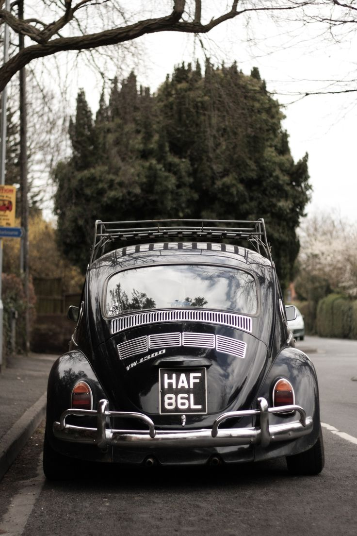 Black vw beetle with chrome details and a kickass fro