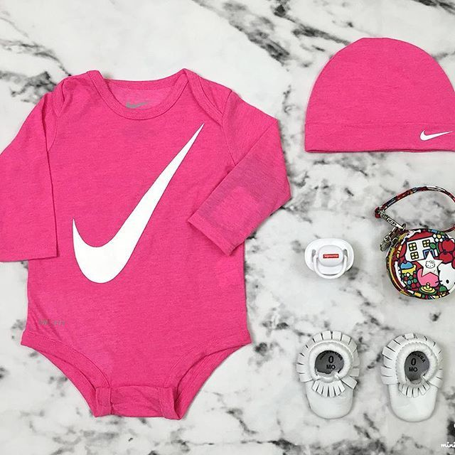 What is your mini rocking' today? Show us what your mini is wearing by #minilicious and #minioutfits #Nike two piece L/S #onesie #FreshlyPicked #Moccasins #Jujube x #HelloKitty paci pod #Wearelittlegiants pacifier Link to purchase #onesies on #minilicious.com/mini-selects #KidsFashion #WDYWTgrid #WDYWT #OOTD #Babyfashion #RookieUSA •