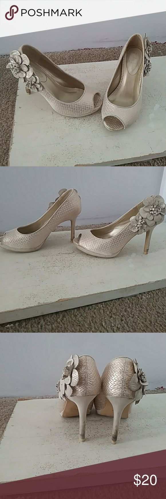 Super cute champagne-colored heels Super cute champagne-colored heels with a nice flower detail on the side is a small and a bigger flower on it size 36 from the brand Ruby shoo a bit dirty on the hill sold as is Modcloth Shoes Heels