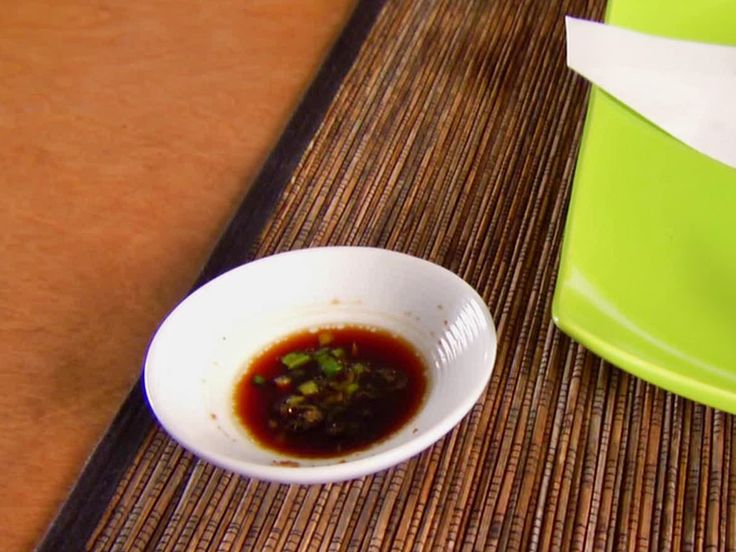 Soy Ginger Dipping Sauce from FoodNetwork.com  substitute 2 tbs of honey for sugar maybe?
