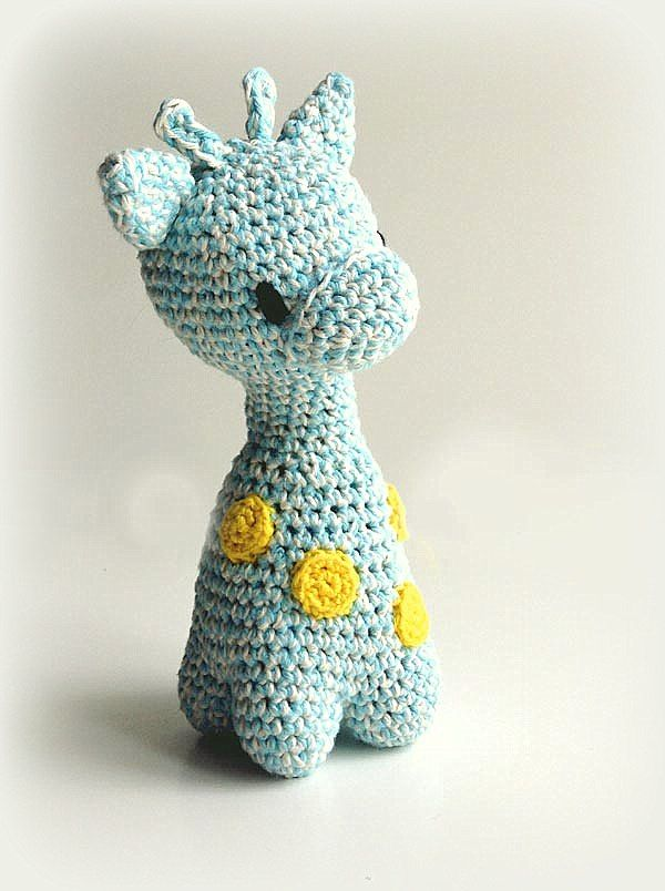 small crochet giraffe in blue with yellow spots