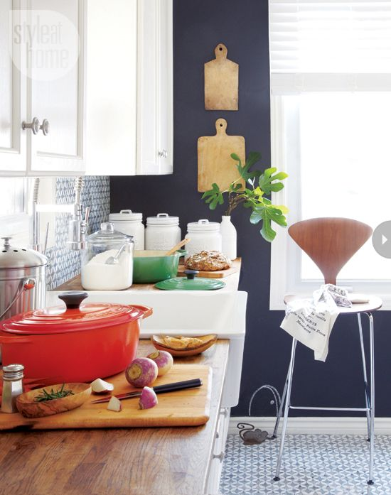 french country kitchen - love the tile, butcher block, enamelware and farmhouse sink.