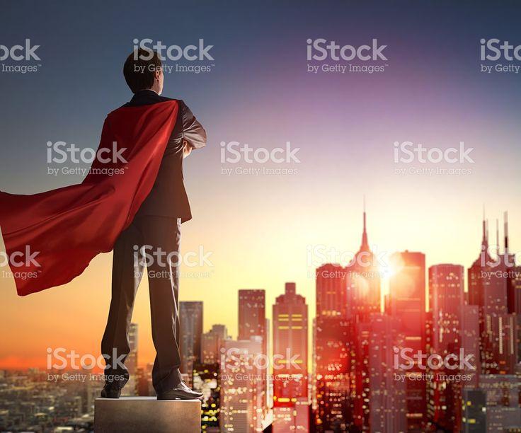 スーパーヒーローのお望みの都市のビジネスマン ロイヤリティフリーストックフォト
