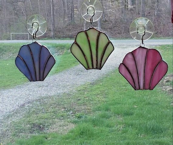 Check out this item in my Etsy shop https://www.etsy.com/listing/518264611/sea-shells-stained-glass-set-of-3-one-of