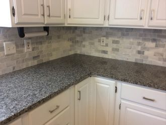 Caledonia Granite With Backsplash Tiles · White Kitchen CabinetsKitchen ...