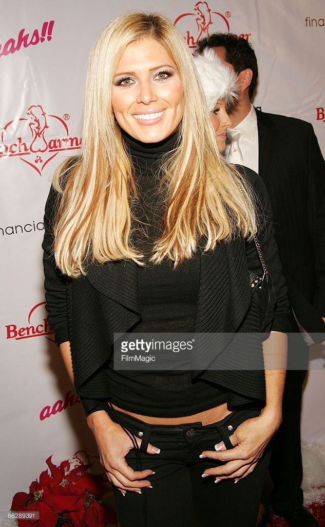 Former WWE wrestler diva Torrie Wilson arrives at the 3rd Annual 'Bench Warmer Trading Cards' Holiday Party and Toy Drive at The Kress on December 9, 2008 in Hollywood, California.