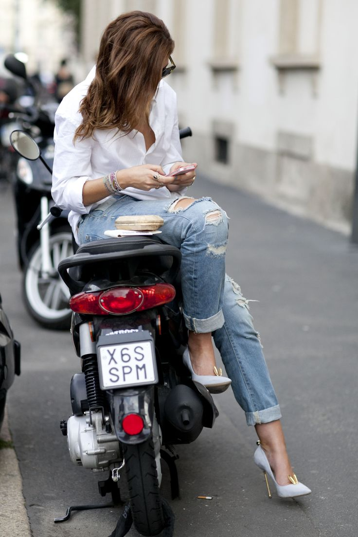 Shredded jeans and designer pumps #MFW #StreetStyle