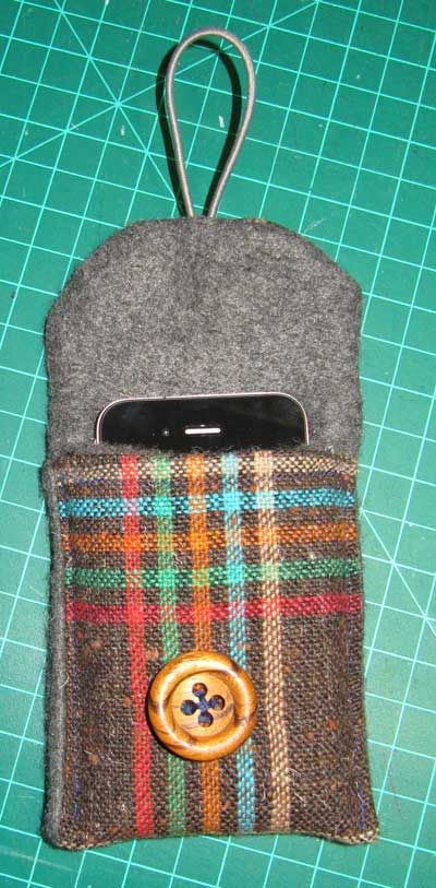 Make your own cell phone holder :) This one looks good for a more masculine person