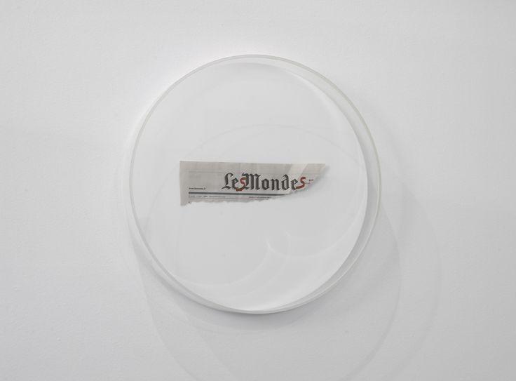 Mircea Cantor - Untitled, 2006  Newspaper, pen, plexiglass  diameter 49 / 7cm