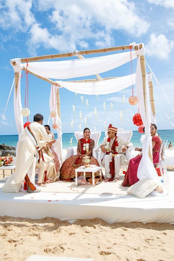 Simple and minimal beach mandap! Fabric canopy in all white against the sandy beach - <3 <3 <3 this! #Decor #indianWeddings | curated by #WittyVows the ultimate guide for the Indian bride | www.wittyvows.com