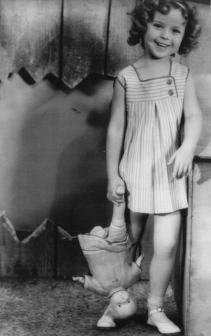 Shirley Temple with vintage doll ,1933.