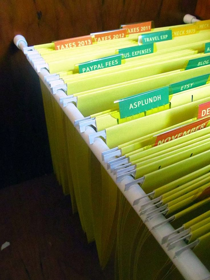 The House on Hillbrook: DIY Hanging File Organization - use tension rods to for hanging file folders