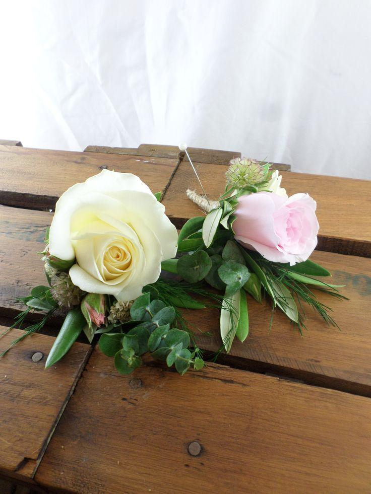 Cottage theme buttonholes in soft pink and creams.