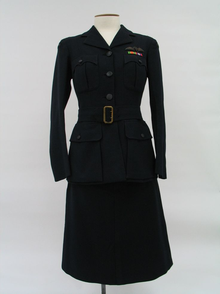 Dark blue Air Transport Auxiliary women's service jacket complete with attached belt with brass buckle. Belonged to Mrs Trevor Colway. From the collection of the Air Force Museum of New Zealand.