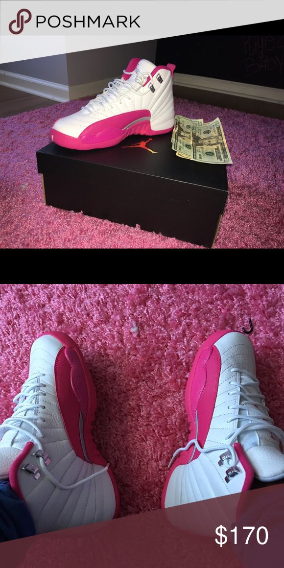 Pink and white Jordan 12's Pink and white 12s worn twice with box grade school size 7 Jordan Shoes Sneakers