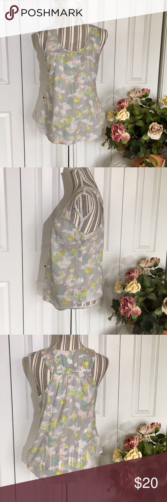 J.CREW FACTORY Dainty Watercolor Cotton Tank This J. Crew Factory watercolor tank is 100% cotton with elastic smocking across the back shoulders for extra comfort and fit.  In grey with pastel watercolor flowers. Dainty and beautiful. Hidden side zip.  Size 4, measurements are approximate: - 18 inches underarm to underarm  - 24.5 inches shoulder to hem in front; 25 inches shoulder to hem in back  No holes, rips, stains, pilling. J. Crew Factory Tops Tank Tops