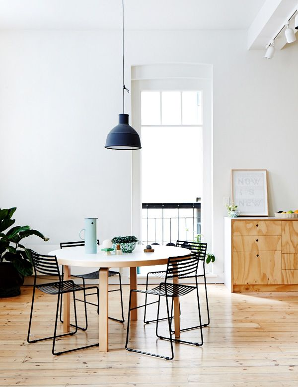 The Melbourne CBD apartment of Dan Honey, Paul Fuog and their two year old daughter Frances. Pendant is 'Form Us With Love' for Muuto, Artek table from Anibou, chairs – a very lucky Camberwell Market find! Photo - Sean Fennessy, production – Lucy Feagins / The Design Files.