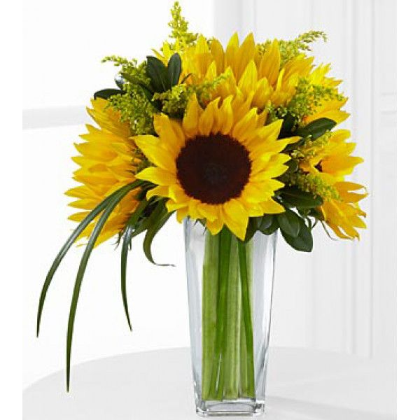 #samedaydelivery : The Sunshine Daydream Bouquet highlights stunning sunflowers to capture their every attention with its bright beauty. Gorgeous sunflowers are accented with solidago, lily grass blades and lush greens to create a memorable flower bouquet.