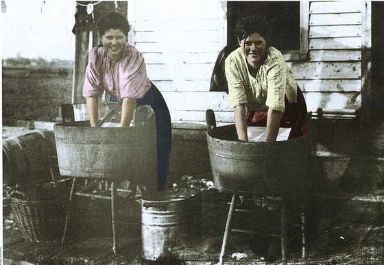 Two women washing clothes - Australia, early 20th Century