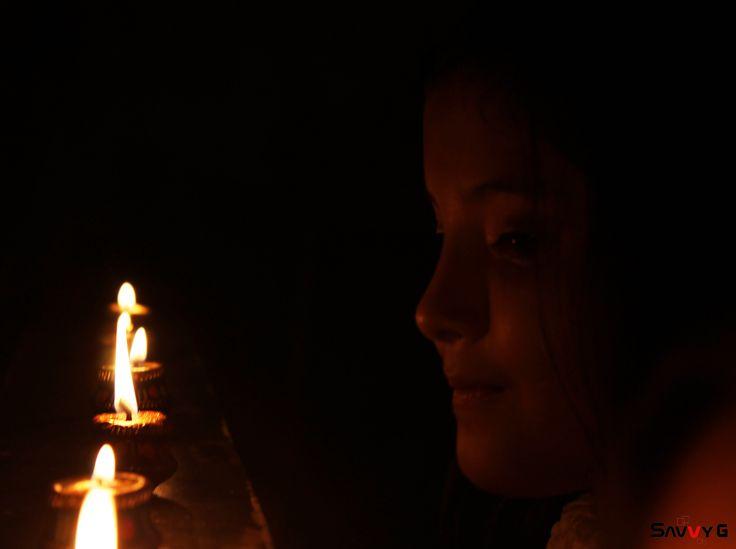 https://flic.kr/p/BjhNYv   Diwali face 2015   Little face looking at Diya.