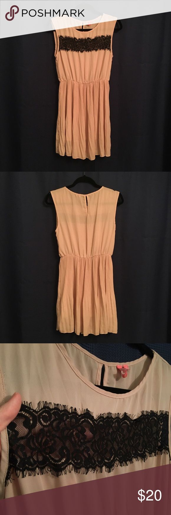 *SALE* Peach colored dress Excellent condition! Peach colored dress with a black Lace stripe size M. No tears or stains! Dresses